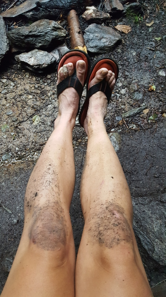 Photo of dirty and muddy legs from hiking all day on the Vermont Long Trail.