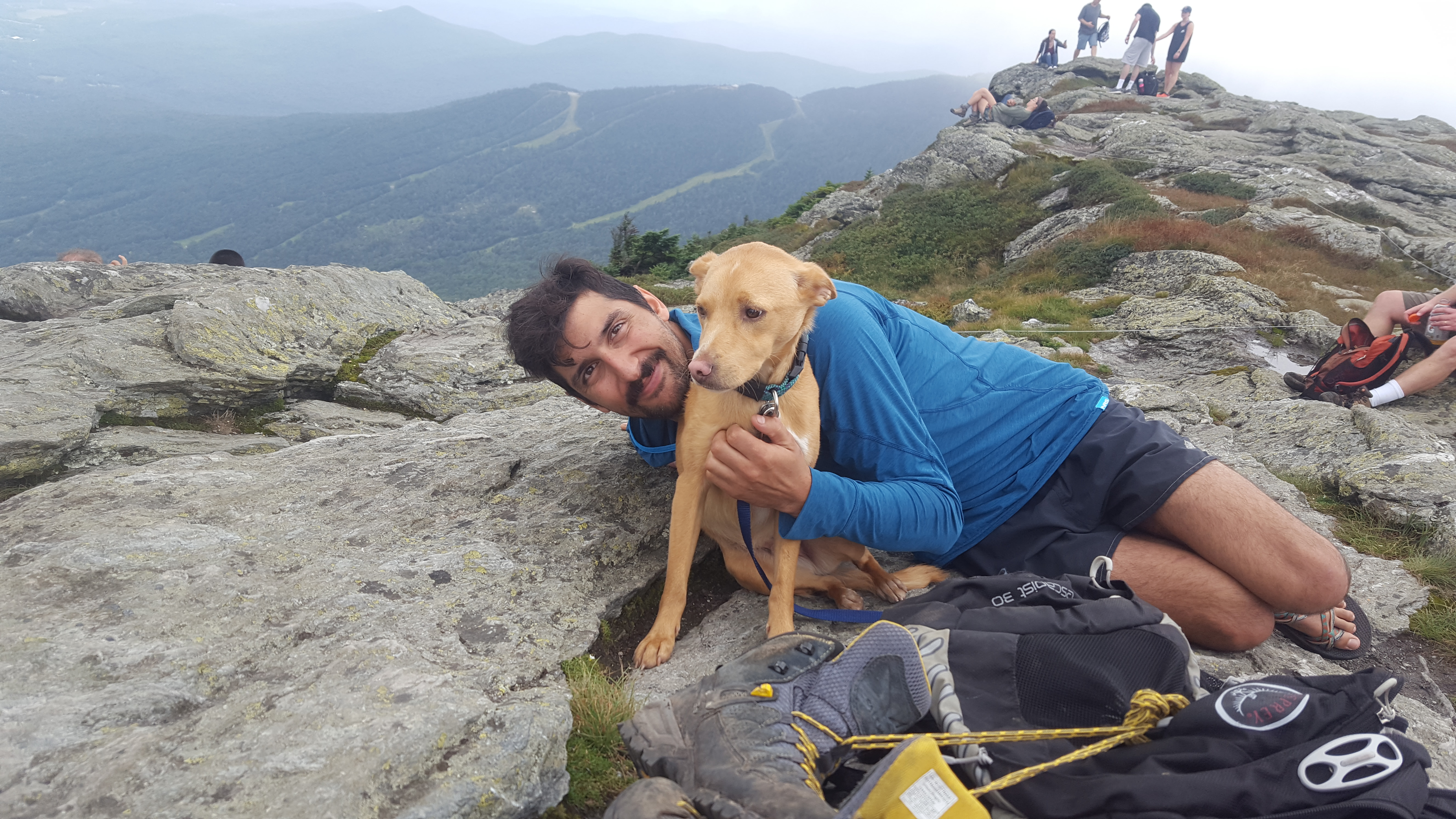 Benny the hiking dog and Dan the boyfriend post for a summit photo on Mount Mansfield in Vermont on the Long Trail.