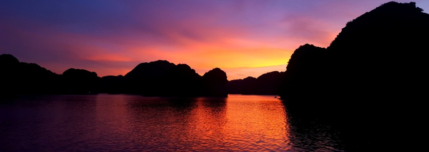 A sunset over the islands of Cat Ba Island in Vietnam, one of the perks for working as an adventure guide for Asia Outdoors,